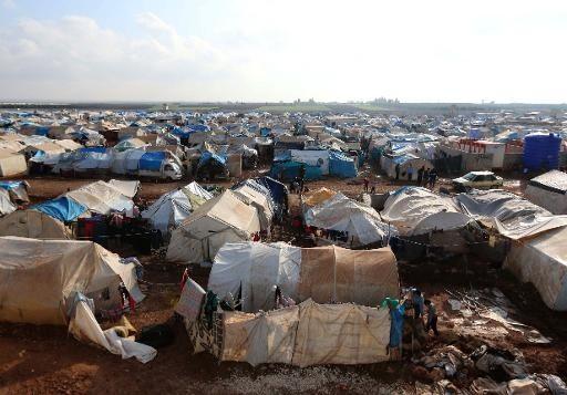 Des-refugies-syriens-11-decembre-2014-dans-camp-Bab-Al-Salama-frontiere-avec-Turquie-dans-plaine-Bekaa_1_730_357